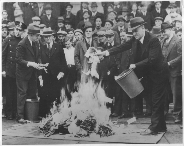 "Crowds gather as hundreds of thousands of dollars in ""Scrip Money"" are burned.  The notes were issued after the bank had closed.  April, 1933. 306-NT-177.567C"