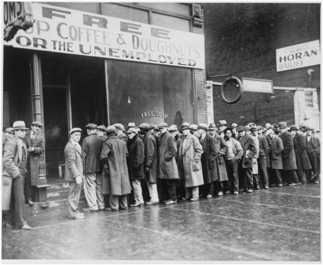 Unemployed men queued outside a depression kitchen opened in Chicago by Al Capone. Feb. 1931. 306-NT-165.319C