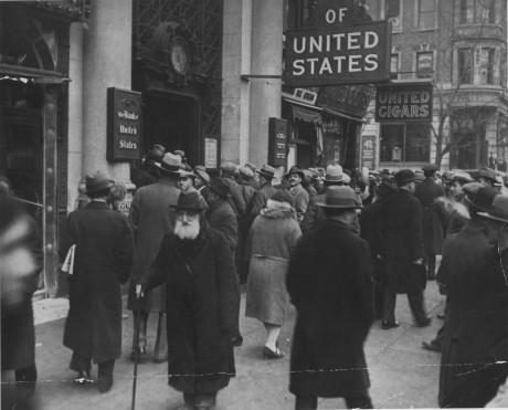 Crowd gathers in front of the doors of the Bank of the United States on Freeman Street, New York.  April, 1931. 306-NT-166.153C
