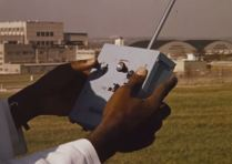 A researcher controls the vest with a model airplane remote.