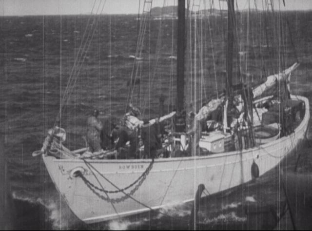 The Schooner Bowdoin was built in 1921 and designed for navigating Arctic waters. She has journeyed north of the Arctic Circle 28 times and currently serves as the official sailing vessel of the state of Maine. Still from BYRD-BYRD-84.
