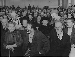 Famous Fratellini clowns bring Christmas joy to Berlin old aged home. 306-NT-483-9. Source: Wide World Photos (Potential copyright restrictions).