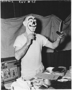 WPA Federal Theatre Circus. Lem A. Ward, producing clown for the circus putting on the make-up. 69-TC-NYC-19-1-95.