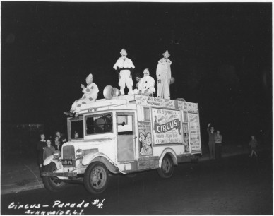 WPA Federal Theatre Circus. Here comes the parade. One of the truck units leaving the ground for big free night parade. 69-TC-NYC-19-12.