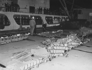 255-CB-86-H-105: Wreckage from the Space Shuttle 51-L mission retrieved from the Atlantic Ocean by a flotilla of United States Coast Guard and Navy vessels was returned to the Trident Basin at Cape Canaveral Air Force Station aboard the United States Coast Guard Cutter Dallas.