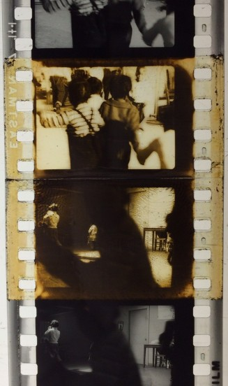 This workprint has tape splices that have discolored the emulsion. There are also visible fingerprints on the film's emulsion. Filmmakers used this copy to edit the negative, which has cement splices.