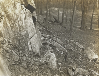 Women's Camouflage Reserve Corps study anti-detection methods, camouflaged against the rocks at Van Cortlandt Park, New York. Local ID: 165-WW-599G-29.