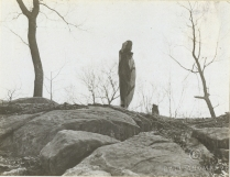 Members of Women's Camouflage Reserve Corps studying anti-detection methods. Camouflaged on top of the rocks. At Van Cortlandt Park, New York City. Local ID: 165-WW-599G-39.