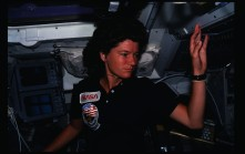 Photographic documentation showing 41G crew activities. View of Mission Specialist (MS) Sally K. Ride on the flight deck (FD). 255-STS-41G-15-002