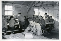 "35-GE-1G-34-524 ""34-524 CCC 1938 Spelling exercises serve in place of setting up exervise (sic) for these members of Co. 544, CCC, Yellowstone Park in Fort Missoula District, CCC, Montana."""