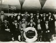 "Original Caption: ""A group of Pilgrims of Party ""S,"" with Capt. Shannon, aboard the AMERICA on the voyage to Europe."" Local ID: 92-GS-2-110."