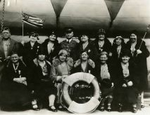 """Original Caption: """"A group of Pilgrims of Party """"S,"""" with Capt. Shannon, aboard the AMERICA on the voyage to Europe."""" Local ID: 92-GS-110."""