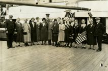 """Original Caption: """"A group of mothers and widows, members of Party """"T,"""" photographed aboard the REPUBLIC with Colonel Williams just before sailing from New York."""" Local ID: 92-GS-118."""