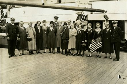 "Original Caption: ""A group of mothers and widows, members of Party ""T,"" photographed aboard the REPUBLIC with Colonel Williams just before sailing from New York."" Local ID: 92-GS-2-118."