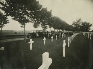 "Original Caption: ""A group of Pilgrims from Party ""T"" arriving at the Aisne-Marne American Cemetery, France."" Local ID: 92-GS-2-123."