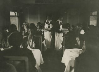 "Original Caption: ""Party ""E"" - June 7, 1931. Pilgrims in diner enroute Cherbourg to Paris."" Local ID: 92-GS-2-186."