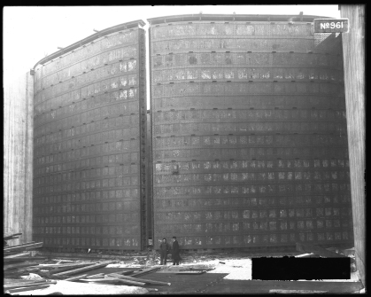 Image shows two men dwarfed by the enormous size of the lock gates.