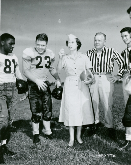 Original Caption: The Southwestern Command, Japan Logistical Command, football season gets underway with Pvt. Cecile Brothers of Hocombe, Missouri, a member of the Camp Saki WAC Detachment, 279th General Hospital, Southwestern Command, JLC, flipping the coin to see who kicks off. Left to right: A/3 Class Eddie Beasley, Sgt. Joe Compton, Atami Air Base, Pvt. Brothers, Sgt Jenkins Beard, Camp Otsu; and Cpl Jim Brogan, Camp Otsu. September 13, 1952. Local ID: 111-SC-406996