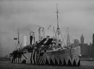 """The SS Leviathan, painted with """"dazzle"""" camouflage, departs Hoboken, N.J., in the film Flashes of Action."""