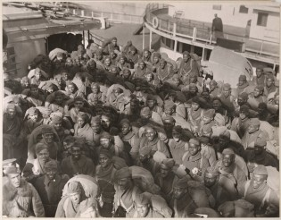 Part of Squadron A, 351st Field Artillery, returning on the transport, Louisville. Most of these men were from Philadelphia, PA. Local Identifier, 165-WW-127-2.