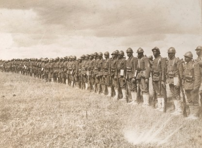 Members of the 369th Regiment in France. Note the French Adrian Helmet. Local Identifier, 165-WW-127-4.