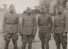 Black officers of the 366th Regiment, 92nd Division on their return to the United States in February 1919. Lieutenant C.L. Abbot, Captain Joseph L. Lowe, Lieutenant A.R. Fisher ( who earned a Distinguished Service Cross), and Captain E. White. Local Identifier, 165-WW-127-6.