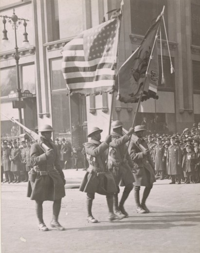 The Colors of the 369th Infantry during the Harlem Victor Parade in February 1919. Note the Colors decorated by the French Government. Local Identifier, 165-WW-127-10.