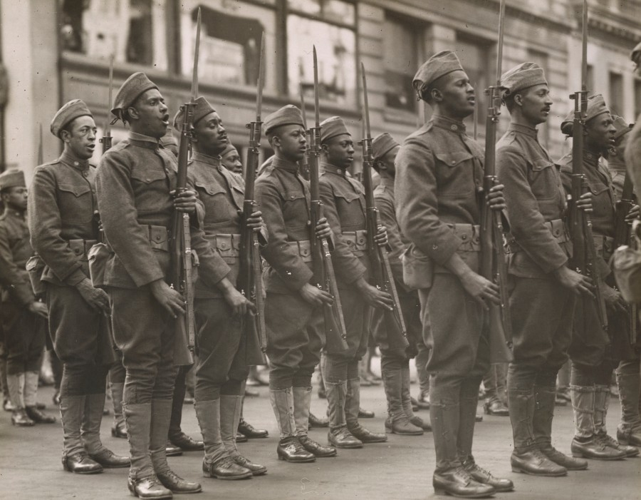 """Members of the 367th Regiment, the """"Buffaloes,"""" presented with colors in front of the Union League Club, New York City.  Local Identifier, 165-WW-127-87."""