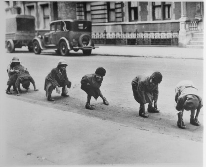 """Black children playing leap frog in a Harlem street."" (Image ID: 306-NT-171.611C)"