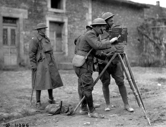 Signal Corps photographers shoot film with a motion picture camera. (111-SC-4386)