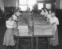 """""""Blind women putting pages together before binding them into magazines or books, which are printed for blind soldiers. The soldiers read by feeling the shape of the letters."""" Date taken: July 26, 1918 (Local ID: 165-WW-32A-4)"""