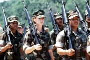 """""""The Marine Corps first all-woman drill platoon marches in formation with M-16A1 rifles."""" Date Taken: July 1985 (Local ID: 330-CFD-DM-ST-86-01726)"""