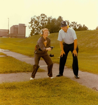 """""""At the FBI Academy, Quantico, VA, a special agent trainee receives instructions on natural point shooting for a FBI firearms instructor."""" Date Taken: February 1976 (Local ID: 65-QT-9-9)"""
