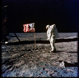 306-AP-A11F-40-5875: Photograph of Astronaut Edwin E. (Buzz) Aldrin, Jr. Posing on the Moon Next to the U.S. Flag