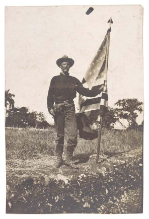 165-SWS-82112: Photograph of a Soldier Holding an American Flag (1898 - 1899)10464_2007_001