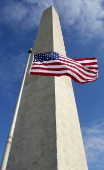 330-CFD-DF-SD-02-03316: The Washington Monument serves as a backdrop for an American flag.