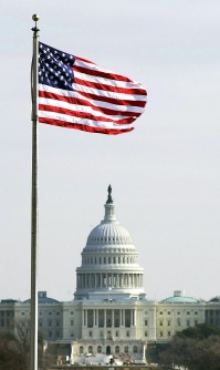 330-CFD-DF-SD-02-03319: Shot of of the US Capitol with an American flag flying over it.