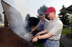 """(Local Identifier: 330-CFD-DF-SD-05-07035) """"US Air Force (USAF) First Sergeants """"Flippin' 'Burgers for a living,"""" USAF MASTER Sergeant (MSGT) Jeff Vaughn, 603rd Air Control Squadron (ACS), and USAF MSGT Geoffrey Kerr, 31st Maintenance Operations Squadron (MOS), man the grill cooking for the First Sergeants Association (FSA) BBQ. The FSA sponsored the BBQ to say thanks for the hard work that members of the Aviano Community put forth in support of Operation IRAQI FREEDOM and Operation YELLOW RIBBON."""""""