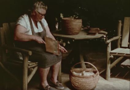 Carding the wool. (Still from Homespun)